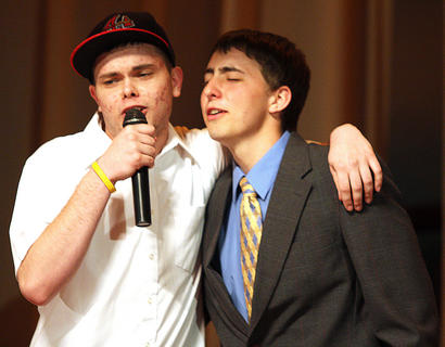 """Tyler Hunt and Bryan Gootee sing Justin Bieber's """"Never Say Never"""" during the Junior Mister competition."""