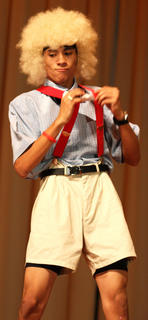 Hector Santiago performs a dance routine during the talent competition.