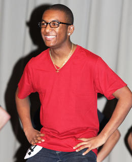 Trell Cooper shows off his pearly whites during the introduction of the participants Saturday evening. He won a self-expression award.