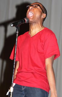 Trell Cooper yells his name to the crowd as he introduces himself Saturday evening. He won a self-expression award.