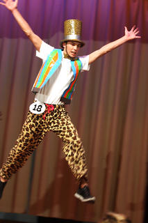 Nic Courtwright leaps into the air during the poise portion of the competition.