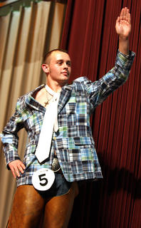 Cody Brahm waves to the crowd during the self-expression portion of the competition. He won a self-expression award and was also named first runner-up.