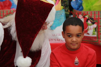 On Saturday, Dec. 15, families from across Marion County got an up close and personal view of Santa Claus courtesy of Lebanon Health and Fitness in Lebanon. Children also had the opportunity to ride a trolley through town. Pictured is Omarrion Burch listens intently to Santa.