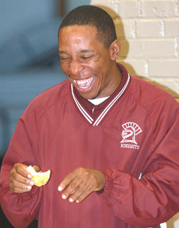 MCHS boys basketball coach Montrell Irvin couldn't help laughing in a preliminary round.