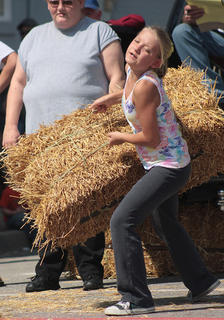 Natasha Higdon tries her best in the hay bale toss.