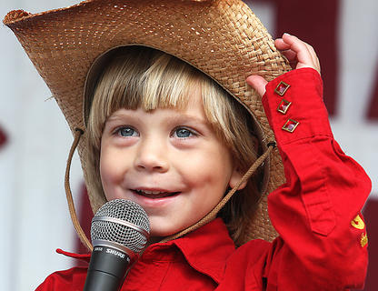 Keegan McKay Cheser charms the crowd during the Jr. Farmer competition Saturday morning.