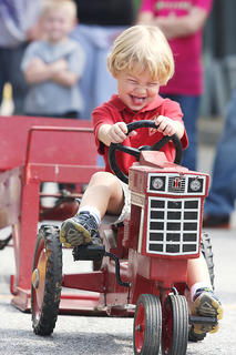Judah Perry competes in the Pedal Pull Contest Sunday afternoon.