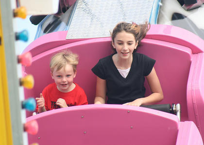 Jeremy Clements, 4, of Mt. Washington and Autumn Drury, 12, of Lexington enjoy a ride on the Rock-N-Roll.