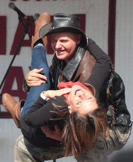 Ashley Roberts of St. Louis gets swept off her feet by Ernie Brown Jr., the Turtle Man.