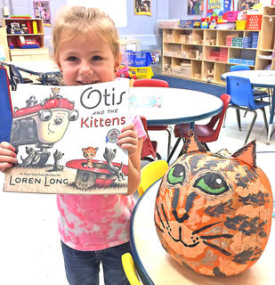 "Ashlynn Bray is pictured with her ""Otis and the Kitten"" pumpkin."