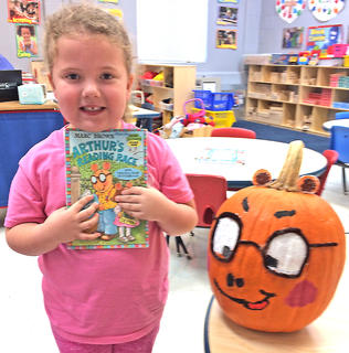 "Evelyn Lucas is pictured with his ""Arthur's Reading Race"" pumpkin."