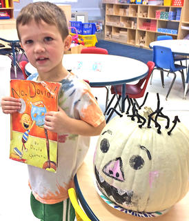 "Oli Mattingly is pictured with his ""No David"" pumpkin."