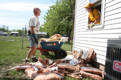 Harold Smith and Lois Brooke share a laugh while cleaning one of several homes in Bradfordsville that were affected by the May 2 flooding. Smith and Brooke are part of the Southern Baptist Convention Disaster Relief Team that helped with clean-up efforts after the flooding.
