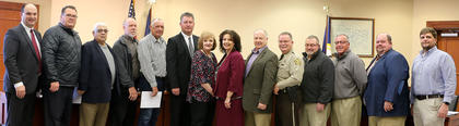 Pictured, from left, are Coroner Alan Mattingly, Deputy Coroner Richard Moraja, Deputy Coroner Tom Colvin, Magistrate Larry Caldwell, Magistrate Jackie Fogle, Marion County Judge/Executive David Daugherty, Marion Circuit Clerk Kim May, Marion County Attorney Lisa Nally-Martin, Marion County Jailer Barry Brady, Marion County Sheriff Jimmy Clements, Magistrate Joe Pat Kirkland, Magistrate John Arthur Elder III, Magistrate Craig Bishop and Marion County Clerk Chad Mattingly.