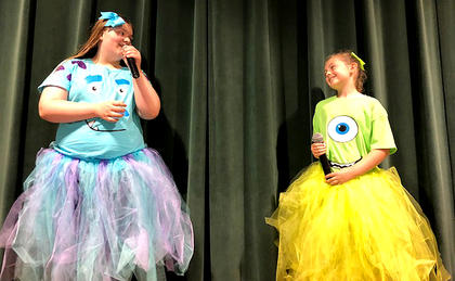 "Amelia Carpenter (Sully) and Brooklynn Day (Mike) perform a scene from the movie ""Monsters Inc."""