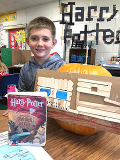 West Marion Elementary School student Andrew Mattingly is pictured with his Harry Potter-themed pumpkin.
