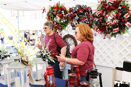 Shoppers enjoy a whole block of local arts and crafts booths on Saturday and Sunday of Marion County Country Hams Days 2018.