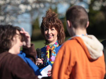 Event organizer Lisa Nally-Martin smiles as she watches the medallion presentation that kicked off Saturday's autism awareness event at Graham Memorial Park.