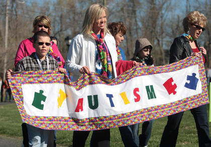 From left, Clayton Tungate, Amanda Mattingly, Summer Crick, Lisa Nally-Martin, Evan Nally-Martin and Linda Welborn lead the first lap of Saturday's Working the Puzzle for Autism Walk.