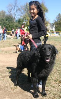 Mya Emmons and Steve (a chow/newfoundland mix) participate in the pet-owner look-alike contest.