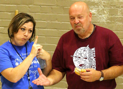 Tina Bickett and Van Gadberry compete during the Slop the Hogs competition on Monday, Sept. 23.