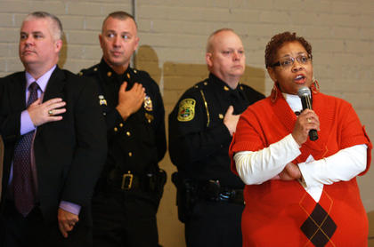 The Marion County Chapter of the NAACP hosted its annual Black History Celebration on Feb. 26 at Centre Square. Opal Young sings the National Anthem as Marion County Superintendent Chuck Hamilton, Lebanon Assistant Police Chief Greg Young and Lebanon Police Chief Wally Brady stand behind her.