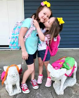 Sisters Lucy and Olivia Bland celebrate the first day of pre-school and first grade together.