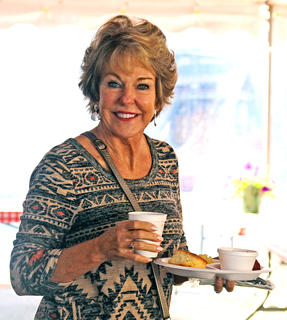 Trudy Langford smiles for the camera as she looks for a seat and prepares to enjoy the country ham breakfast at the Marion County Country Ham Days Festival on Saturday morning. This year's breakfast was catered by the Country Store in Bradfordsville.