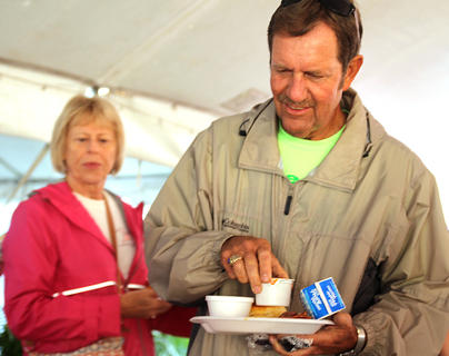 John G. Mattingly and his wife, Janet, get some orange juice and milk to wash down their country ham breakfast on Saturday morning. This year's breakfast was catered by the Country Store in Bradfordsville.