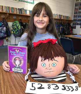 "West Marion Elementary School student Casey LaRue is pictured with her ""Junie B. Jones Is Not a Crook"" pumpkin."