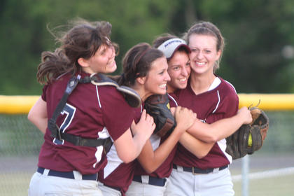 From left, Coco May, Allye Hamilton, Christan Montgomery and Allison Mattingly celebrate after winning the 20th District softball tournament in May. This was the first district title for the Marion County softball team since 2003.