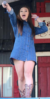 "Georgia Bronson of Bardstown gets the crowd involved during her rendition of ""Any Man of Mine"" by Shania Twain at the Central Kentucky Idol Show at Ham Days on Saturday."