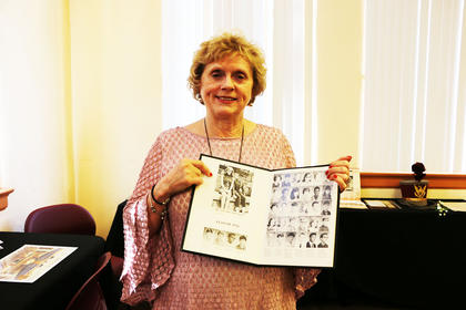 Wanda Buckler shows off her old yearbook and a photo from Freshman year at Lebanon High.