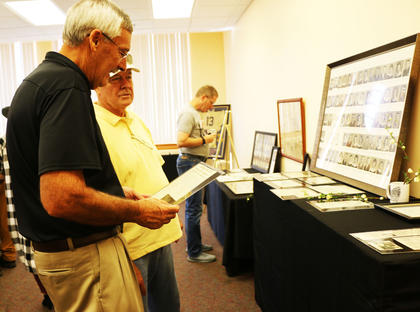 Roger Marcum and John O. Thomas look at old photos from Lebanon High.