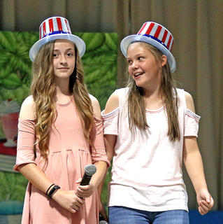 Kinzlee Ford (left) and Klaire Benningfield (right) host a comedy routine involving students guessing the answers to their jokes.