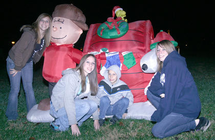 From left, Hannah, Krista and Joshua Andrews of New Hope and Kayla Paul of Logan, N.J., gather with Charlie Brown and Snoopy.