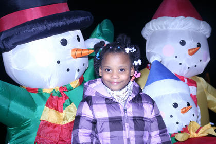 Kamiya Brown, 5, of Lebanon jumped in for a photo with the snowman family.