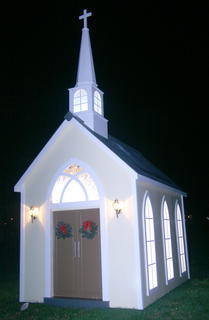 A small church is also among the decorations at the park.