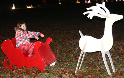 Bailey Sagrecy takes a ride in a sleigh during Christmas in the Park on Wednesday.