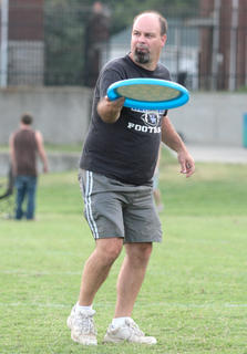 Steve Weber prepares to toss an oversized flying disc to ...