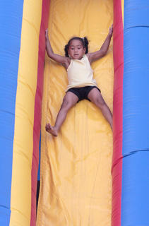 Janyla Sallee, 4, enjoys another trip down the slide.