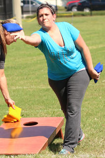 Jennifer VanDerver of Batesville, Tennessee tosses a cornhole bag at the cornhole tournament at Ham Days on Saturday.