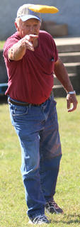 Don Cooper of Stanford, Kentucky keeps his focus as he tosses a cornhole bag at the cornhole tournament at Ham Days on Saturday.