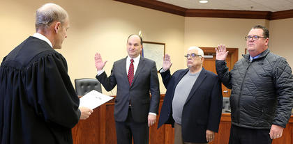 Pictured, from left, are Coroner Alan Mattingly, Deputy Coroner Tom Colvin and Deputy Coroner Richard Moraja and Dbeing sworn in. Also pictured is Marion Circuit Judge Todd Spalding who administered the oath of office.
