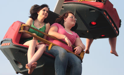 Whitney Newbury (left), 17, and Kaitlyn Smith, 14, go for a ride on the Superman.