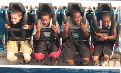 From left, Trent Mays, Tyren Bell, Shaion Taylor and Lamarcus Bell enjoy their ride on the Tsunami.