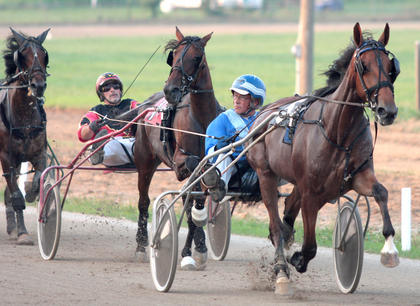 Steve Waller, driving Serene Lady, held the lead after the first lap during a two-year old filly trot Wednesday night at the Marion County Fair. Serene Lady went on to win the race.