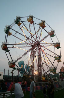 Ferris wheel riders go for a spin as the sun sets Wednesday.