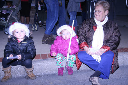 Laken, 4, and Kaylen Huff, 3, wait for the parade to start with their great-grandmother, Francis Nalley.