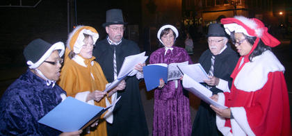 Opal Young, Sue Reynolds, Frankie Reynolds, Nancy Luckett, Wendel Luckett and Angela Nance roamed the streets singing Christmas carols for anyone who wanted to hear.